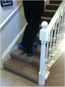 calf stretch on stairs